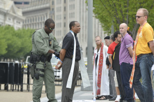 The Rev. John L McCullough is arrested at a Civil Disobedience action in Washington. D.C. with other faith leaders and Rob Rutland-Brown, Executive Director of National Justice for Our Neighbors.
