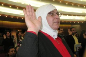 Maytha proudly takes the oath of citizenship.