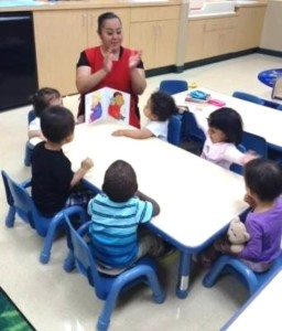 Nancy leads her class in a reading game.