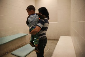Mother and son in a small holding cell, commonly called hieleras. Americans for Immigrant Justice.